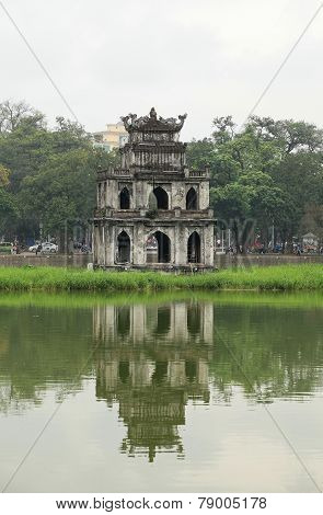 View of Turtle Tower on a small island on Hoan Kiem lake