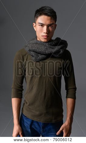 portrait of a handsome young man wearing scarf