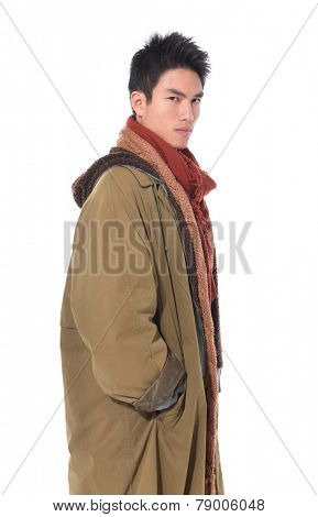 Side view Pensive stylish young man wearing overcoat posing