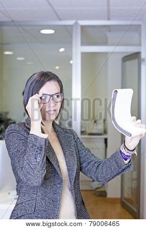 Trying On Glasses Holding A Mirror