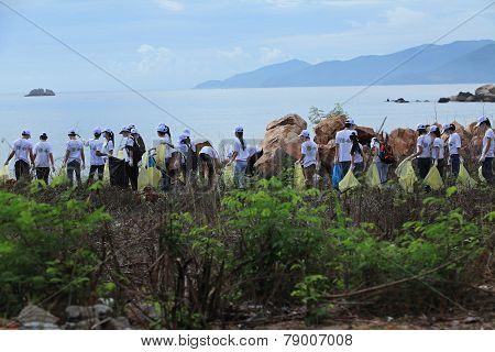 Students of Nha Trang University cleaning the beach within a volunteer event for environment saving