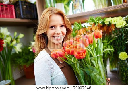 Female grower of flowers looking at camera