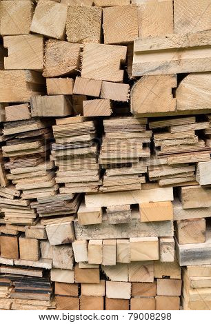 Piled squared timbers and boards
