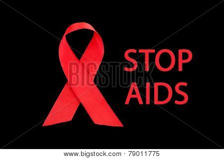 Red ribbon HIV, AIDS on black background