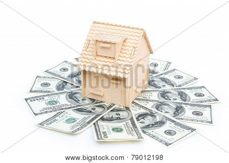 House Stands On Stack Of Usd Paper Currency On White