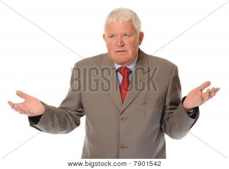 Successful Mature Businessman Shrugging