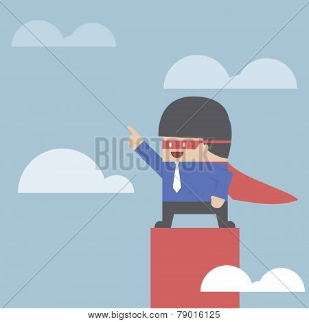 Super Businessman Standing On The Top Of The Graph