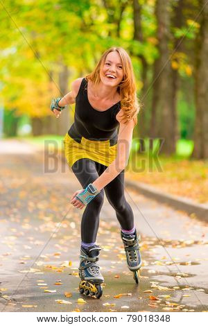 Laughing Girl Roller-skating In The Autumn Park One