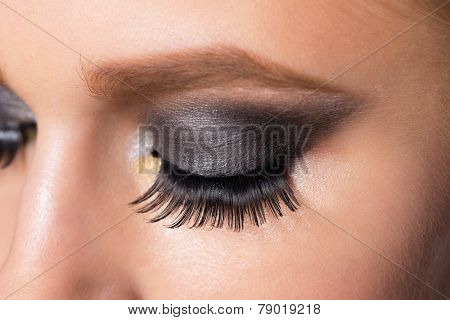 Closeup image of beautiful woman eye with fashion makeup.