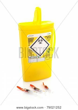 Yellow Medical Sharps Disposal Box On A White Background