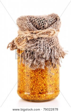 Dijon Mustard in glass jar isolated on white