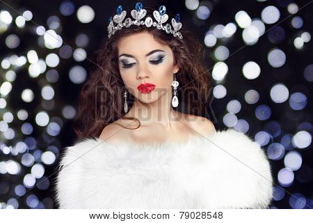 Winter Beauty Fashion Girl Model In Fur Coat Over Boker Christmas  Lights Background. Luxurious Glam