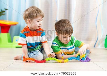 kids playing rail road toy