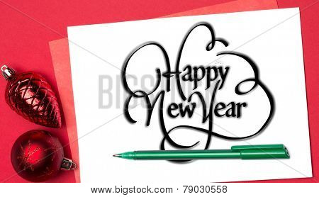 Happy new year against page with red christmas baubles and pen