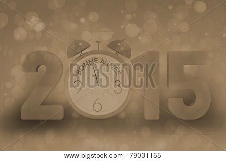 2015 with alarm clock against pink abstract light spot design