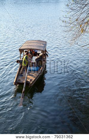 Traditional Chinese Wooden Boat On West Lake, Hangzhou
