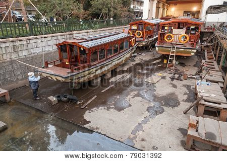 Traditional Chinese Wooden Recreation Boats Under Renovation