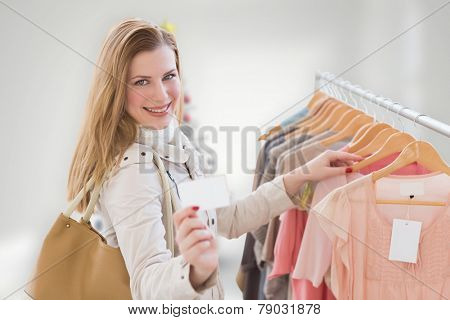Blonde shopping against blurry christmas tree in room
