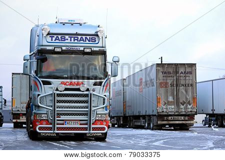 Fleet Of Scania Trailer Trucks On Icy Yard