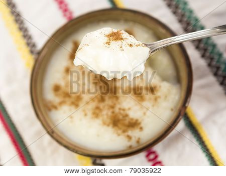 Spoon With Milk And Rice