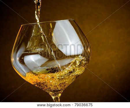 Pouring White Wine Into A Glass With Space For Text, Warm Atmosphere
