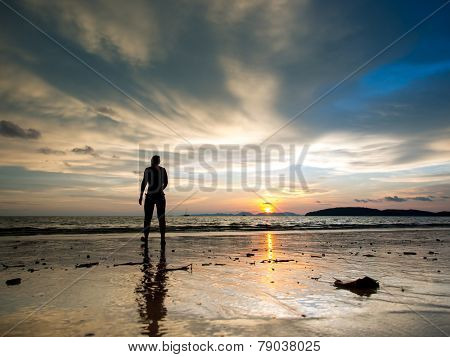 Woman at Sunset on the beach of Ao Nang in Krabi Thailand