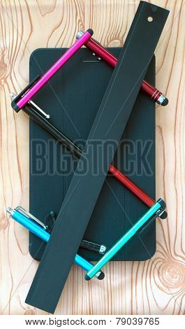 Business composition of modern things business man: stylus in the form of the dollar and tablet