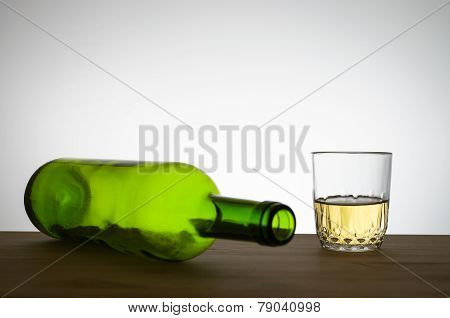 Wine Bottle And A Glass Of Wine On A Table