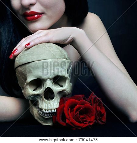 Brunette with human skull and roses