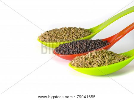 Indian Brown Mustard Seeds and cumin seeds isolated on white background