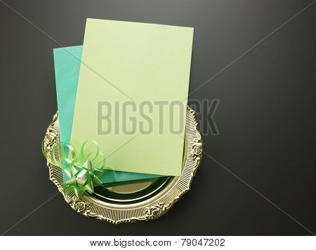 invitation card on the golden plate