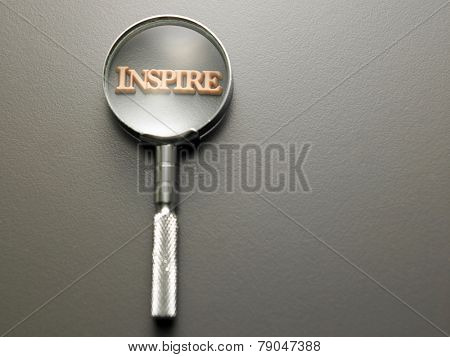 magnifying glass focus on alphabet inspire