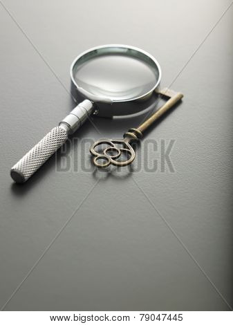 magnifying glass and a key