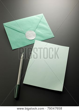 blank card with the green envelope with  thank you sticker