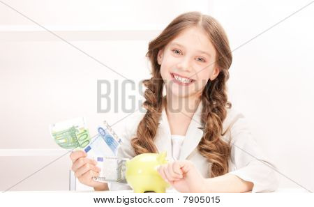 Little Girl With Piggy Bank And Money
