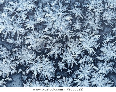 Snowflakes And Frost On Window Pane Close Up