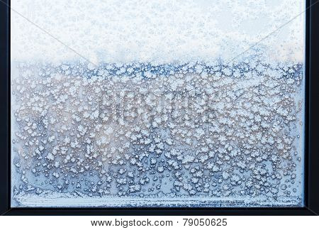 Snowflakes And Frost Pattern On Frozen Windowpane