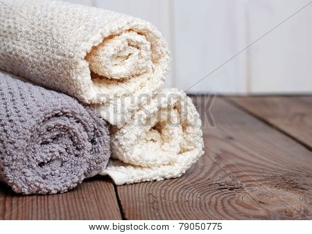 Rolls Of Pure Towels On A Wooden
