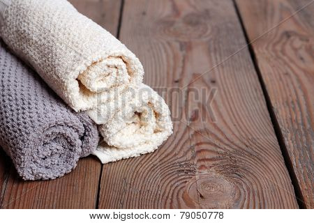 Rolls Of Pure Towels On A Wooden Table