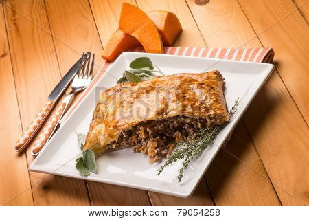 strudel stuffed with chopped meat pumpkin and herbs