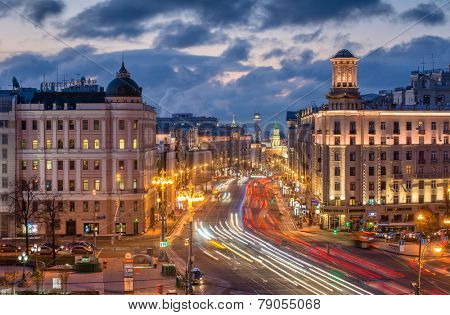 MOSCOW, RUSSIA - OCT 23, 2014: Tverskaya Street in Moscow at evening, far visible towers of the Kremlin