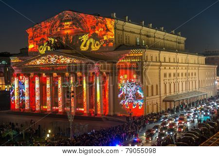 MOSCOW, RUSSIA - OCT 11, 2014: Bolshoi Theatre with an holiday illumination near spectators watch