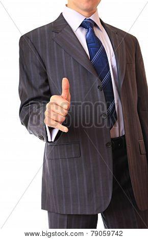 A businessman shows a gesture.