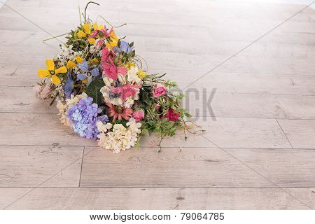 Flowers On A Wooden Floor