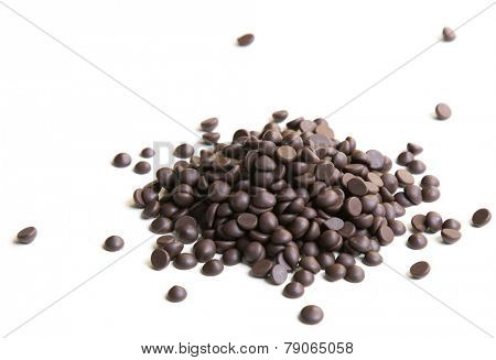 Chocolate morsels pile on white background
