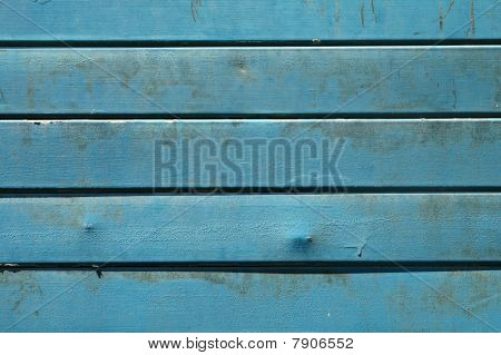 Metal Surface With Blue Paint And Rust