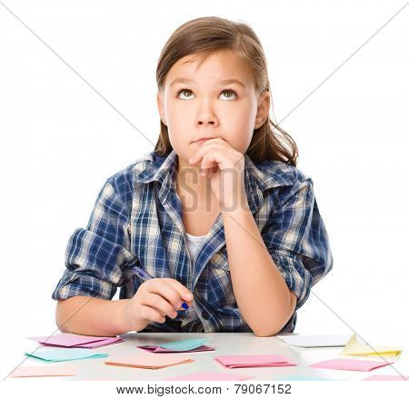 Girl is writing on color stickers using pen, planning concept, self-organization, isolated over white