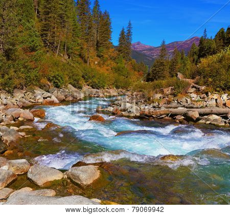 Pastoral in the Alpine mountain valley in Austria. Cascades of cold water at the source of the famous Krimml waterfalls.