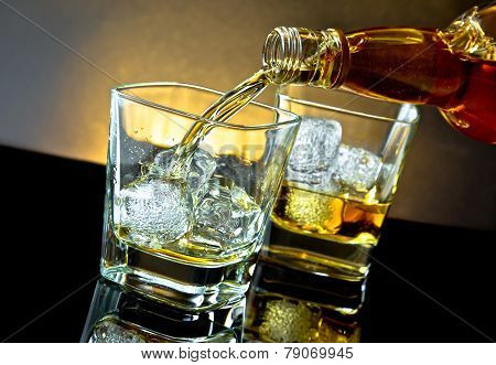 Barman Pouring Whiskey In Front Of Whiskey Glass On Warm Light