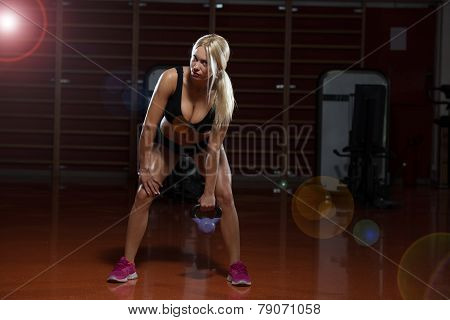 Muscular Woman Exercise With Kettlebell